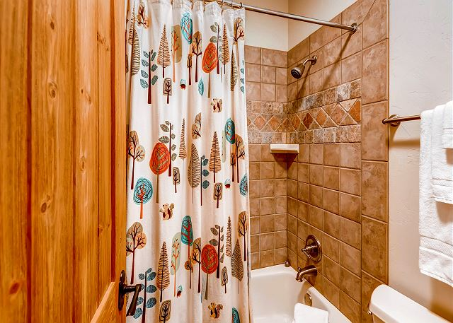 with two sinks and tub/shower combo