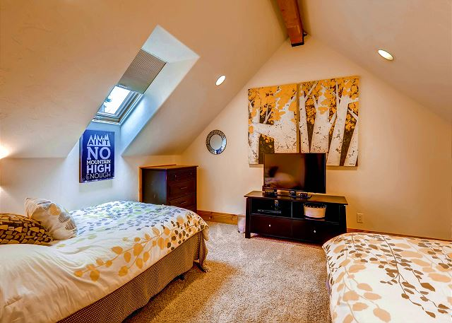 - two full size beds, shares bath with Jean-Claude Killy King Suite