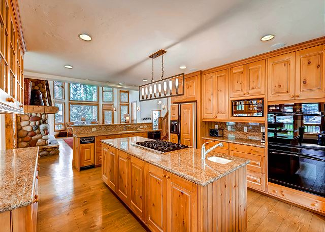 featuring Double Ovens, Gas Cooktop, Bar Seating, Two Sinks and Plenty of Workspace