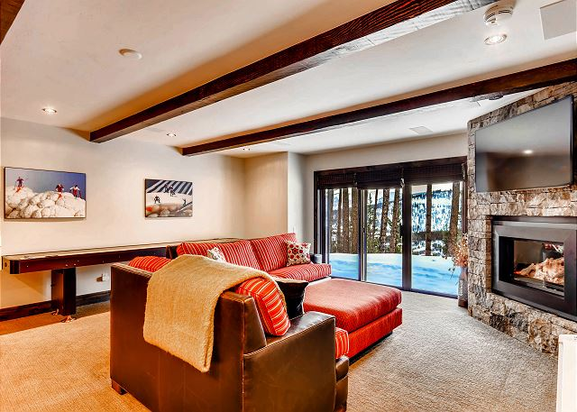 features a large TV and fireplace