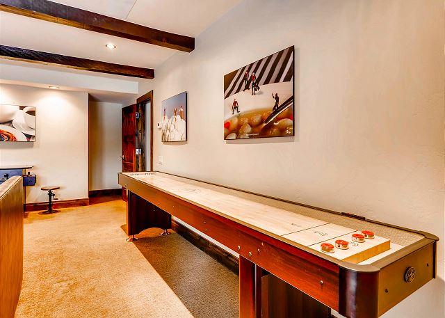 Enjoy shuffleboard in the lower den.
