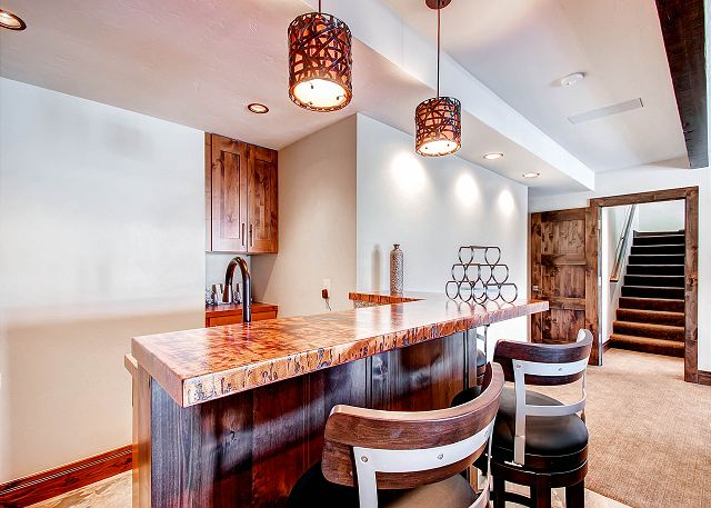 Wet Bar in Lower Level Den with Bar Sink and Refrigerator