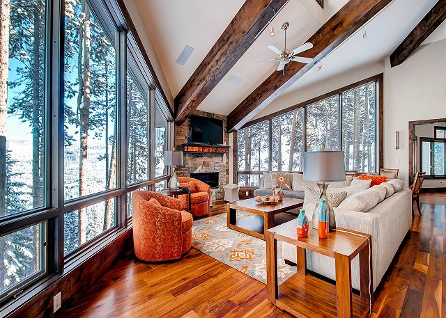 Great Room surrounded with windows - flat screen TV and Gas Fireplace