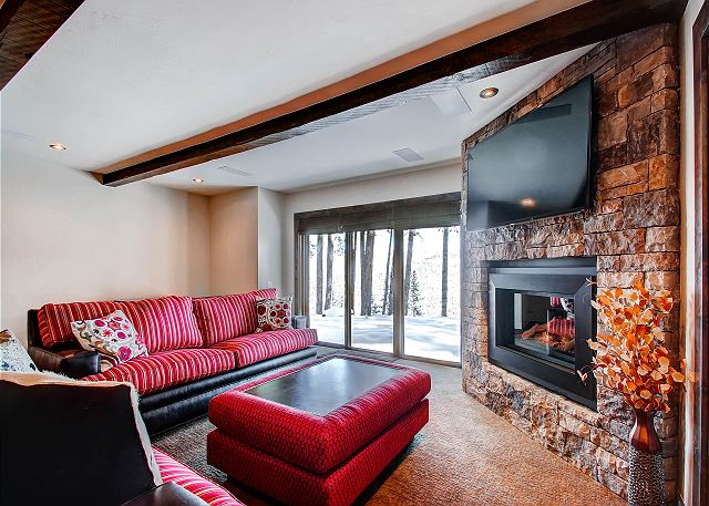 Lower Level Den with Flat Screen TV, Gas Fireplace and Wet Bar (not shown)