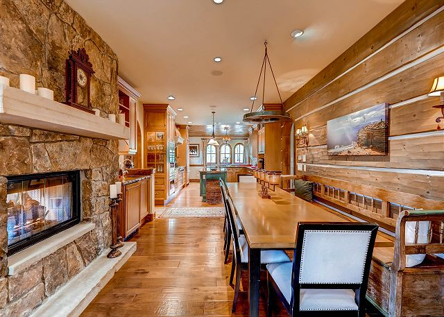 Dining Area opens into Kitchen and features two-sided gas fireplace