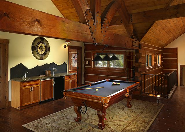 - Vacations aren't complete without a billiards room with wet bar!