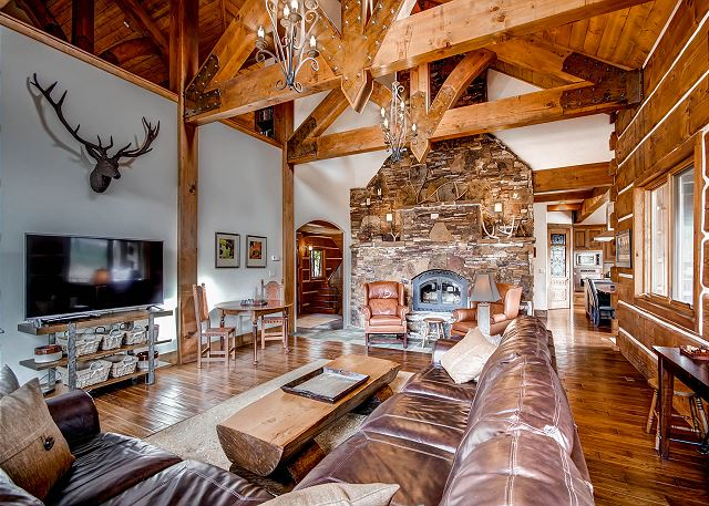 Great Room features fireplace, flat screen TV and access to wrap around deck with views!
