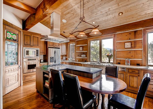 well lit kitchen with views out every window