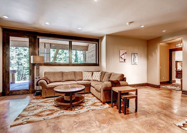 features large sectional sofa, TV, Foosball Table (not shown), Game Table and Patio Access
