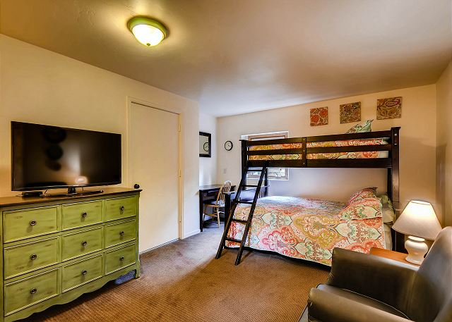with Captain's Bunk (sleeps 3), desk and sitting area with TV
