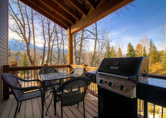 Balcony with outdoor seating and BBQ Gas Grill