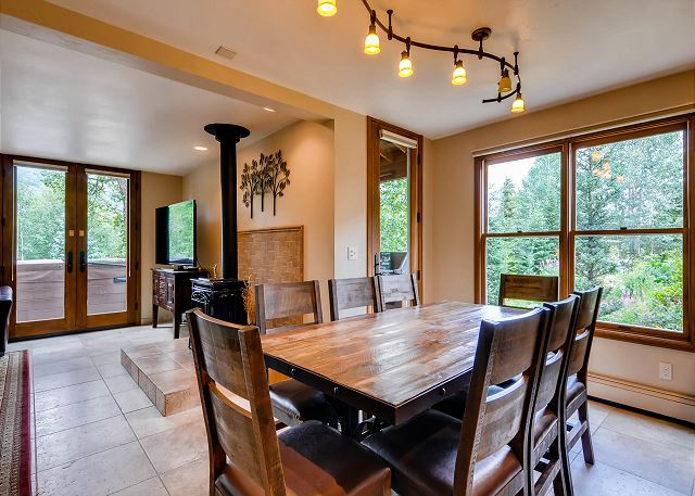 opens into living area and kitchen - Deck with BBQ grill and outdoor seating out the side door
