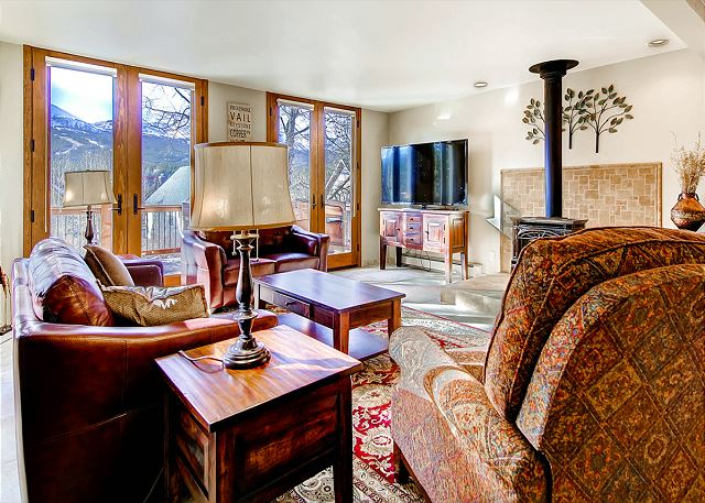 Living Area features great views, large TV and gas wood stove -- opens to Dining Area and Kitchen