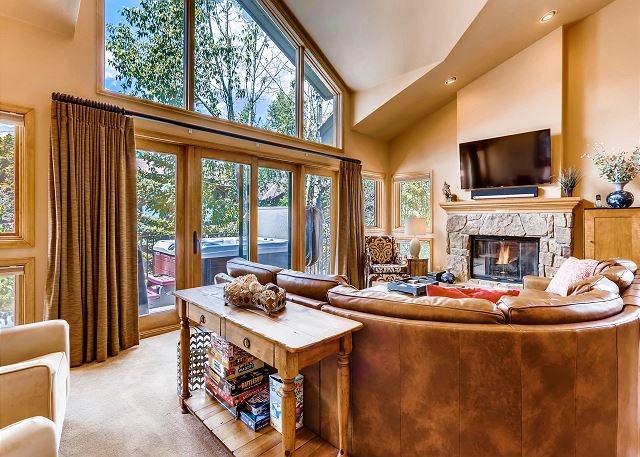 features TV, comfy sectional sofa, gas fireplace and floor to ceiling windows