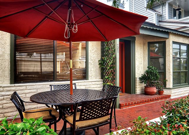 Cozy outdoor patio complete with a gas BBQ and patio furniture