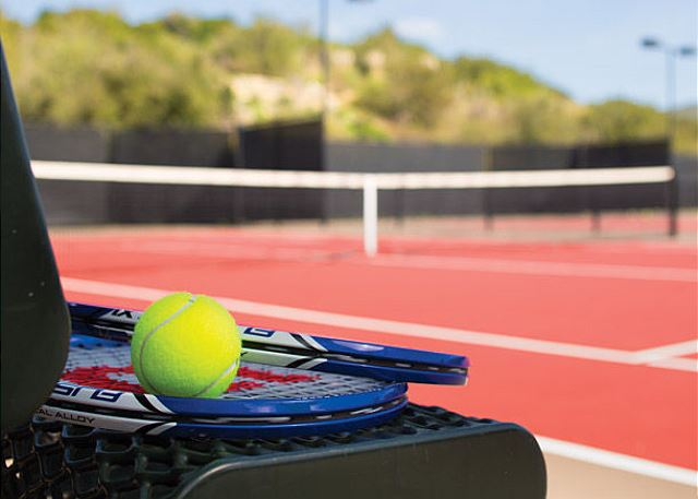 Polish your game at Marriott's three tennis courts.