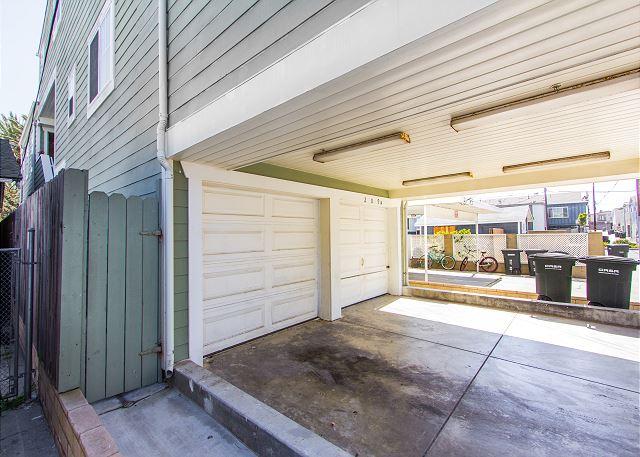 1 garage spot and 1 carport parking behind it (tandem).