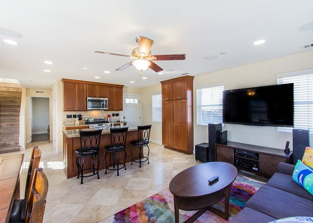 Open concept living room with large TV