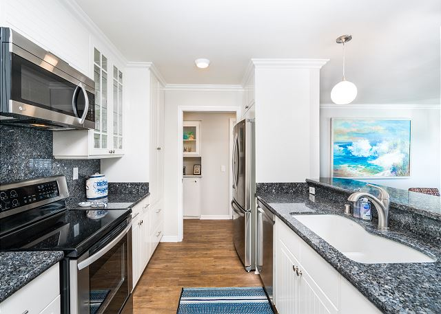 This oceanfront condo features a full-kitchen