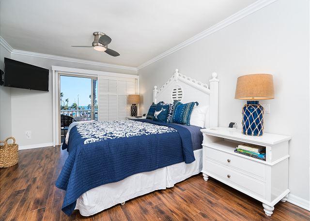 Master bedroom with TV, ocean views and en suite bath