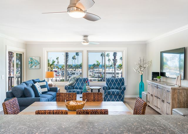 The interior living space displays views of the Pacific Ocean