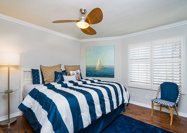 The second bedroom features a king-sized bed and has a flat-scre