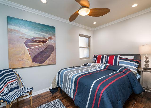 The third bedroom has a queen bed