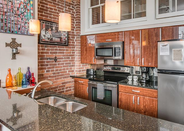 "Stone Counter Tops, High-End, Modern Cabinets...so ""URBAN COOL"""