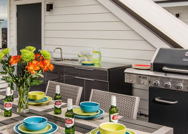 Roof Deck has Outdoor Kitchen, Gas Grill, Dining Table and Lounge Area!