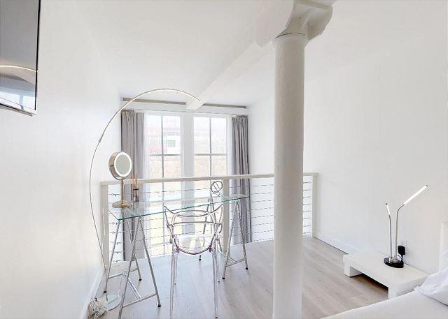 Bedroom has a Desk / Vanity for Convenience