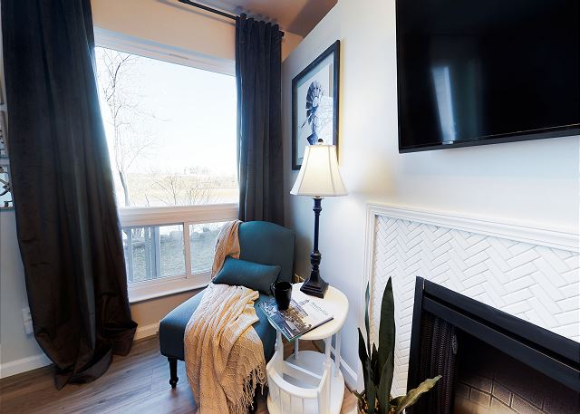 The PERFECT reading nook with a view of the River next to the fireplace