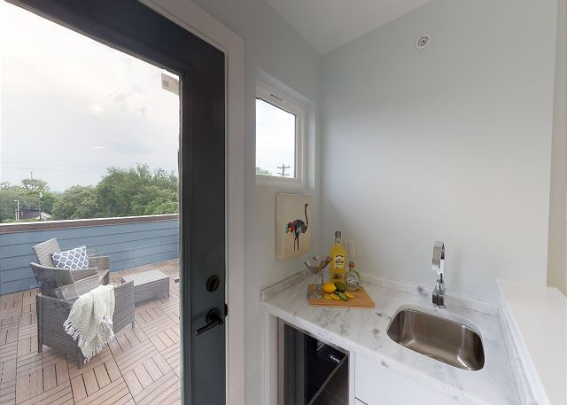 Wet Bar Leading out to Rooftop Terrace