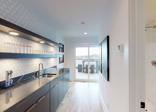 Large, Well-Appointed Wet Bar Inside Rooftop Decks