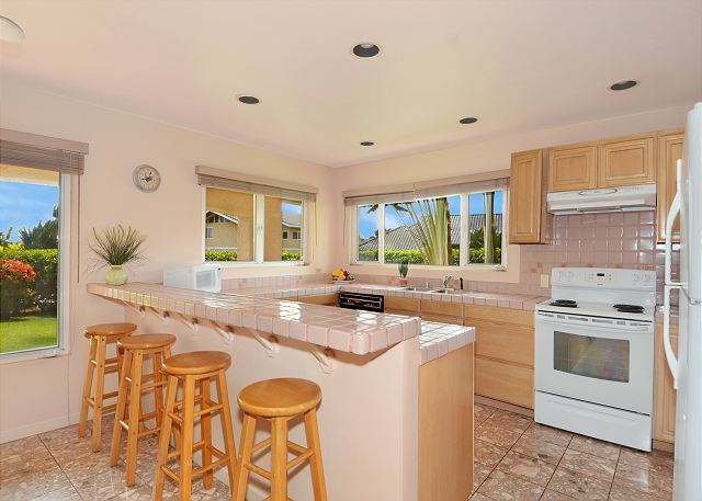 Shaka Hale has a huge kitchen with views to the back and side yard gardens.