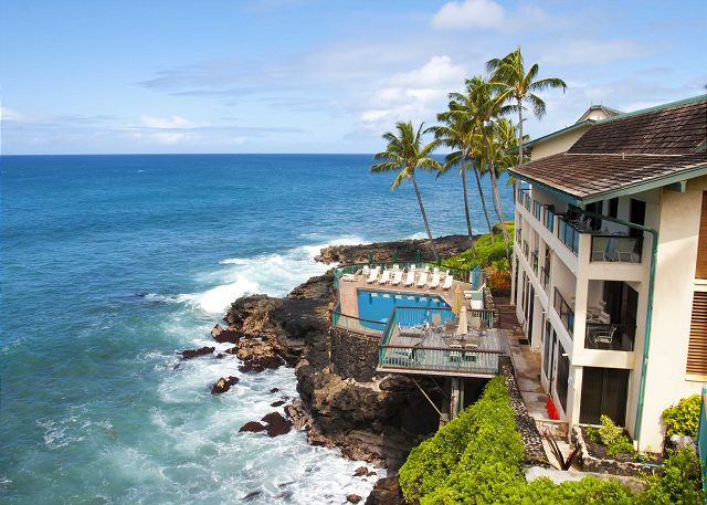 Outstanding view of the most scenic pool in Poipu with swaying palms in the background.