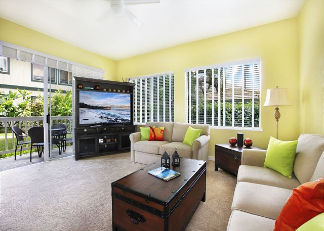 65 Inch Flat Screen TV, comfortable new furniture in a cozy living area with a queen sleeper sofa.