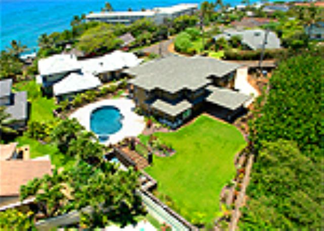 Stunning and spacious with 4 master suites, Poipu coastline sunset views, lagoon pool with spa and gazebo, beautiful green lawns, tropical plants, surrounded by lava roack walls.  Your dream vacation home come true!