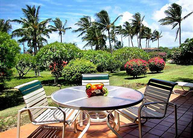 Enjoy the outdoor lanai nestled amidst the lovely gardens at Manualoha.