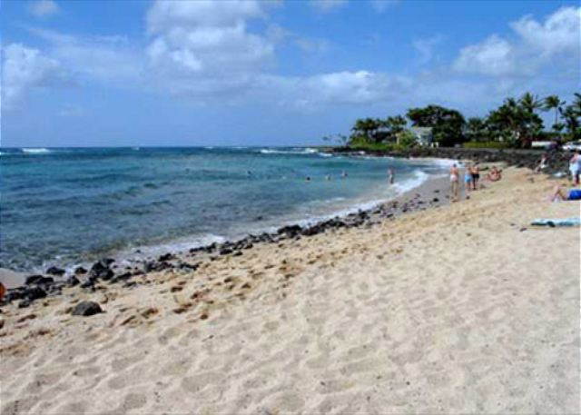 Crescent shaped sandy beach footsteps from Kuhio Shores