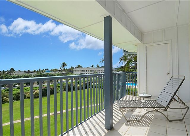 Poipu Sands 333 spacious covered lanai with pool and ocean views