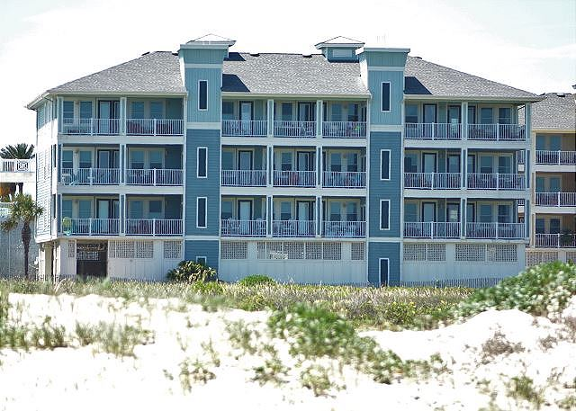 YOUR CONDO BUILDING TAKEN FROM THE BEACH - YOUR UNIT IS TWO LEVELS ABOVE THE PARKING GARAGE ON LEFT END. FRONT ROW BEACH FRONT.