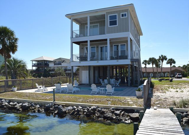 This beautiful home has great outdoor space with private pool, private pier and spacious deck space.
