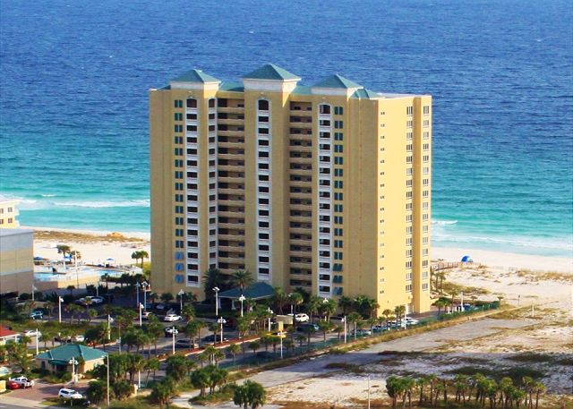 This Gulf front condominium offers swimming pools, hot tub, fitness center and beach access.