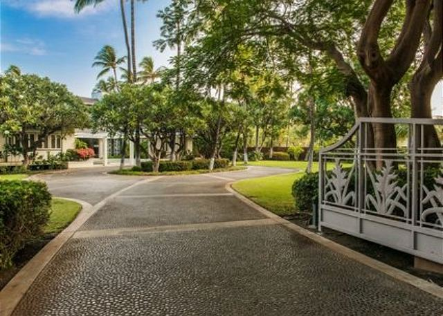 Privacy and exclusivity await behind the entry gates of this two acre ocean front estate.