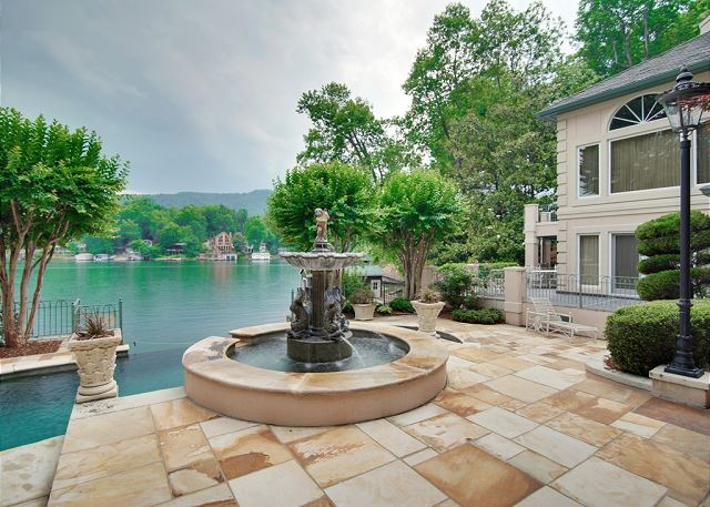 Located off the main channel of Lake Lure, this exquisite estate home has a private beach, great outdoor spaces and a private, heated infinity pool