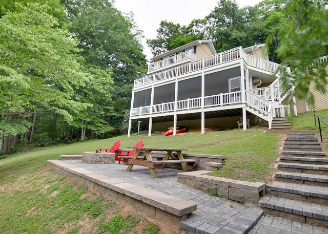 Lovely lake home with lower level screen porch, outdoor fire-pit and picnic area, pontoon boat (in season), kayak, paddle board and paddle boat!