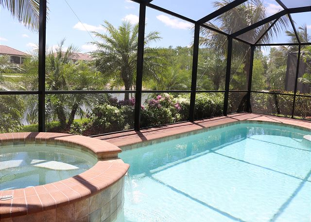 Screened in pool area with private heated pool and spa. Tropical landscaping offers privacy.
