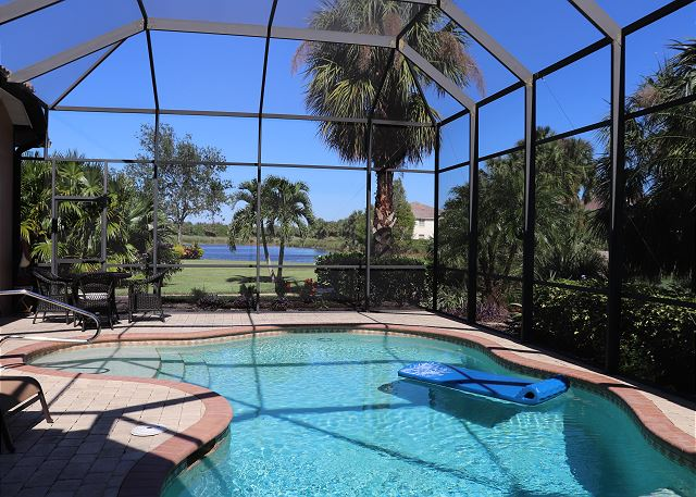 Enjoy the sparkling water and gorgeous lake and golf-course view of the private heated pool & spa!