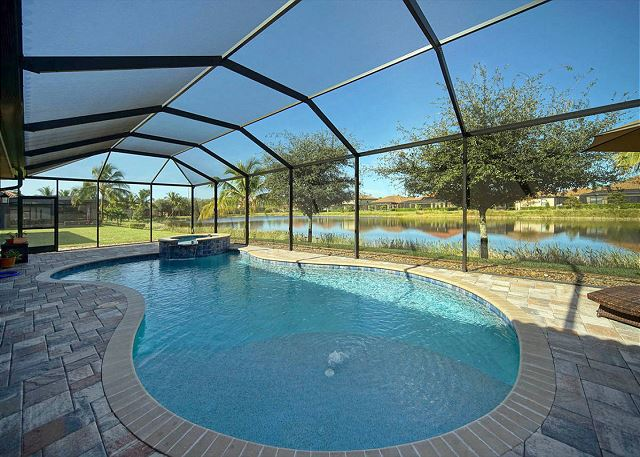 **Soak up the Sun by the Heated Pool Overlooking the Sparkling Lake**