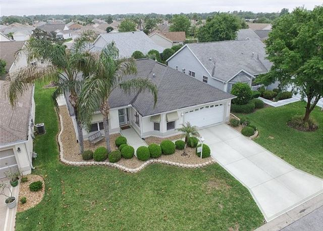 JUST LISTED AWESOME LOCATION AND GORGEOUS HOME W/4 SEAT GAS GOLF CART!